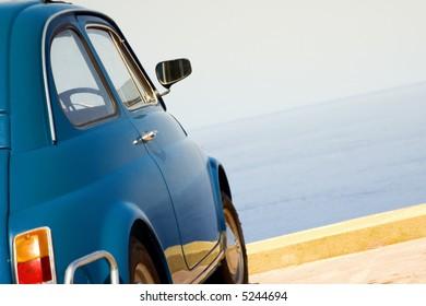 travel destination: vintage car parked near the sea