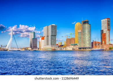 Travel Destinations. Cityscape View of Rotterdam Harbour and Port in Front of Erasmusbrug (Swan Bridge) on Background. Horizontal Image
