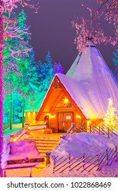 Travel Destinations Concepts. Unique Lapland Suomi Houses Over the Polar Circle in Finland at Christmas Time. Located in Front of Amazing Winter Forest Scenery in Finland.Vertical Image