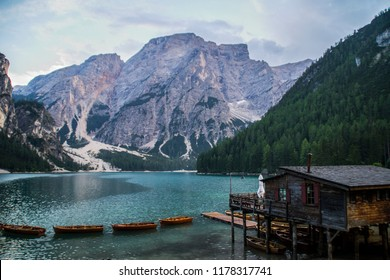 Travel Dolomites, Italy.Breathtaking summer landscape view of iconic boathouse and wooden boats on romantic Lago Di Braies (Pragser Wildsee). Tourist popular attraction/destination in South Tyrol Alps