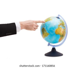 travel, earth, geography and business concept - close up of businessman pointing finger to earth globe