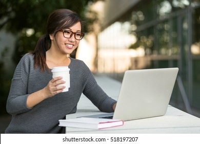 Travel e-learning business university student studying outdoor with laptop casual lifestyle