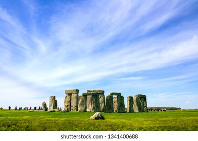 Travel England, United Kingdom. Popular tourist destination in Europe. The ancient monument, famous, mysterious Stonehenge attraction. Sunny day, blue sky. Travel/outdoor background.
