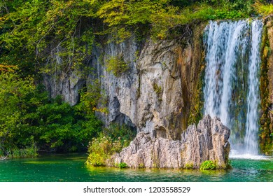 Travel to the fabulous country of the Plitvice Lakes. Lovely small waterfall falls from a vertical ledge.  The concept of ecological, active and phototourism