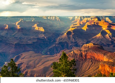 travel with family to Grand Canyon National Park which is the landmark of one of the seven wonders, see the orange sunlight pass though canyon and the cloudy sky after heavy rain in the summer day