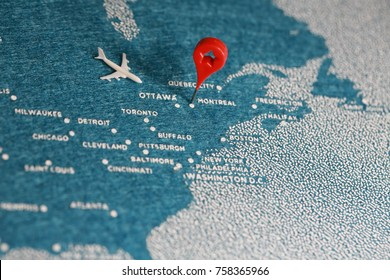 travel felt painted map with pin in Canada