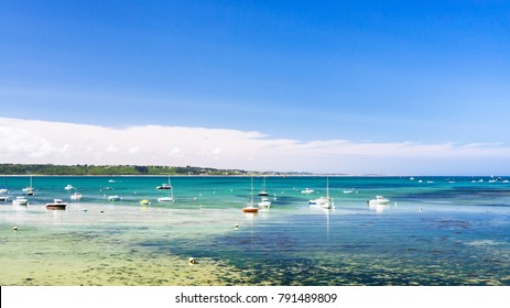 travel to France - bay Anse de Perros of English Channel near Perros-Guirec commune on Pink Granite Coast of Cotes-d'Armor department in the north of Brittany in sunny summer day