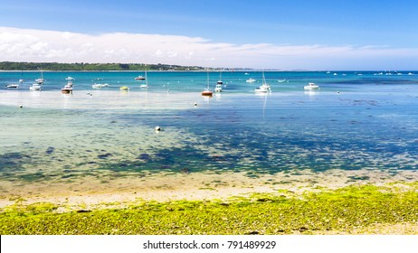 travel to France - boats in bay Anse de Perros of English Channel near Perros-Guirec commune on Pink Granite Coast of Cotes-d'Armor department in the north of Brittany in sunny summer day