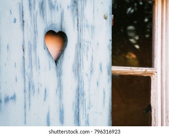 Travel to France - heart shaped pattern carved in outdoor wooden shutter in old house in Petite France quarter of Strasbourg city