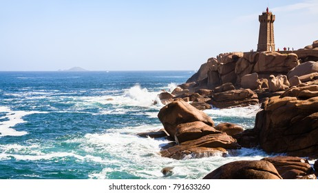 travel to France - lighthouse in Ploumanac'h site on rocky coast of English Channel with of Perros-Guirec commune on Pink Granite Coast of Cotes-d'Armor department of Brittany in sunny summer day