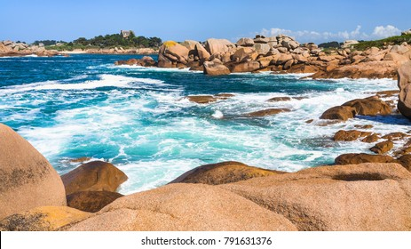 travel to France - stone shore of English Channel in Ploumanac'h site of Perros-Guirec commune on Pink Granite Coast of Cotes-d'Armor department in the north of Brittany in sunny summer day