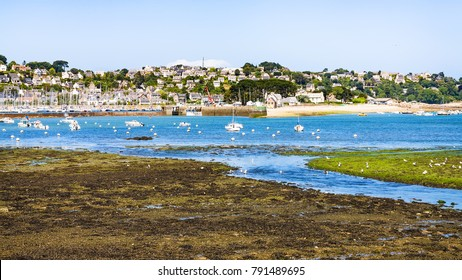 travel to France - view of Perros-Guirec commune through estuary of river Kerduel and bay Anse de Perros in Cotes-d'Armor department in the north of Brittany in sunny summer day