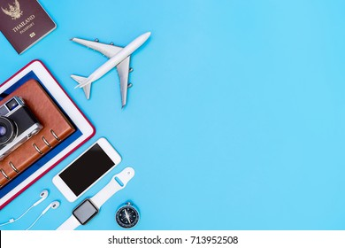 Travel gadgets and objects on blue copy space