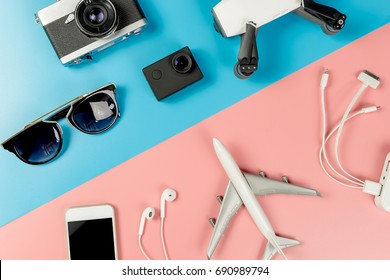 Travel Gadgets on blue and pink pastel background