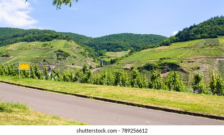 "travel to Germany - road and vineyards along Mosel river in Cochem - Zell county on Moselle wine route in summer day (Text on the road sign: town ""Zell/Mosel"", ""region Kaimt"", ""county Cochem - Zell"")"
