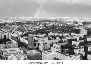 Travel to Germany. View of the houses and streets of Berlin with a bird's-eye view. Overcast sky. Double Rainbow