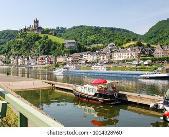 travel to Germany - view of waterfront of Cochem city and Reichsburg Cochem castle in summer day