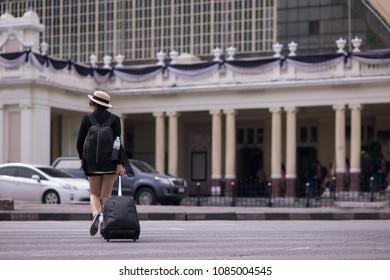 travel girl cross the road