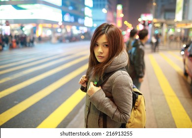 travel girl lost in city, standing in the road