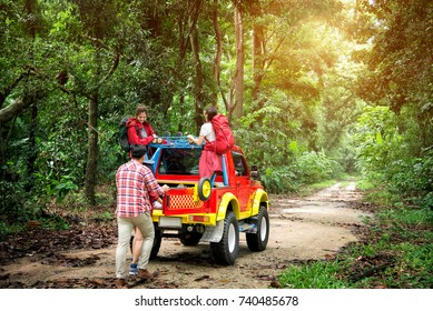 Travel Group of Young Asian Backpacker Enjoy Road Trip on 4WD Off Road Adventure in the Forest in Thailand - Holiday Concept