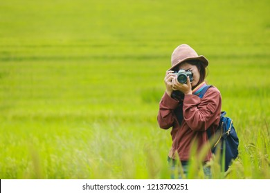 travel guide,Cheerful woman tourist with Holding a camera and shoulder bag,Travel and holidays,