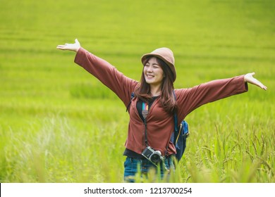 travel guide,Cheerful woman tourist with Shoulder bag and ,Travel and holidays,