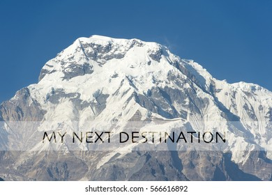 TRAVEL HAPPLY MUST TRAVEL LIGHT word over the background of the mountain. Motivation quotes for Travel and Adventure.