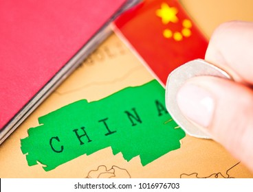 Travel holiday to China concept with passport and flag with female hand choosing China on the map