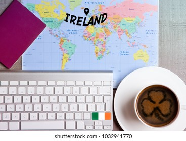 Travel holiday concept with coffee and map with flag on keyboard and passport on wooden table. Travel to Lisbon Portugal