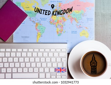 Travel holiday concept with coffee and map with flag on keyboard and passport on wooden table. Travel to United Kingdom