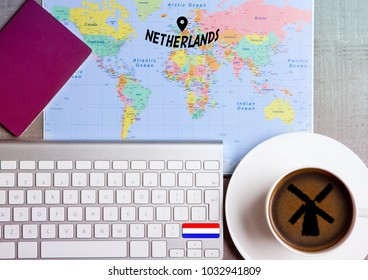 Travel holiday concept with coffee and map with flag on keyboard and passport on wooden table. Travel to Czech Republic