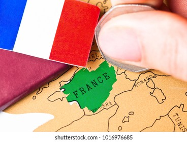 Travel holiday to France concept with passport and flag with female hand choosing France on the map
