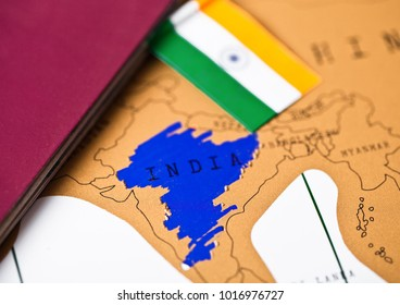 Travel holiday to India concept with passport and flag