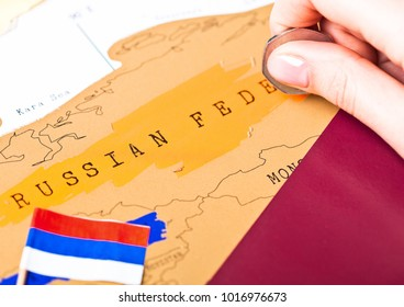 Travel holiday to Russia concept with passport and flag with female hand choosing China on the map