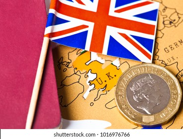 Travel holiday to United Kingdom concept with passport and flag and one pound coin on the map