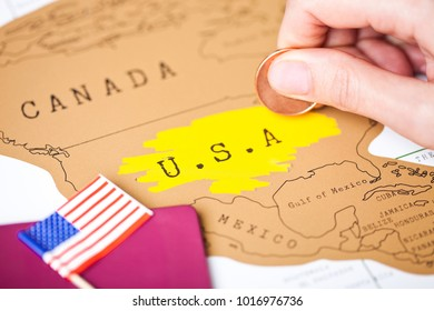 Travel holiday to United States of America concept with passport and flag with female hand scratching map choosing USA