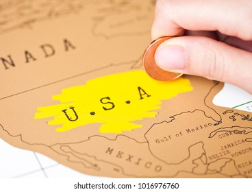 Travel holiday to United States of America concept with female hand scratching map choosing USA