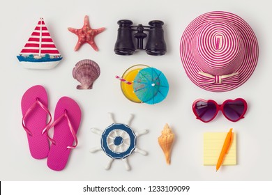 Travel holiday vacation concept with beach and travel items organized on white background. Top view from above. Flat lay