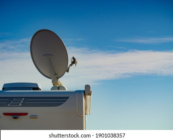 Travel holidays in motorhome. Satellite dish on roof of camper car. TV connection.