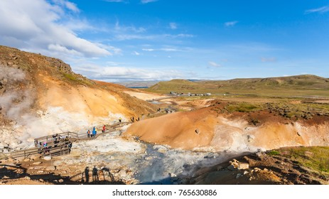 travel to Iceland - people at observation deck in geothermal Krysuvik area on Southern Peninsula (Reykjanesskagi, Reykjanes Peninsula) in september