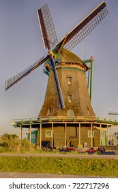 Travel Ideas and Concepts.TLine of Traditional Dutch Windmills in the Village of Zaanse Schans, in the Netherlands. Vertical Orientation
