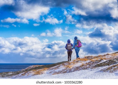 Travel Ideas.Mountain Destinations. People Travelling Through the Mountains of Lofoten Islands in Norway.Horizontal Image