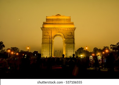 Travel in India: tourists enjoy the view of India Gate in New Delhi, India.