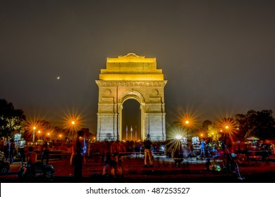 Travel in India: View of India Gate at night with a lot of activities in New Delhi, India.