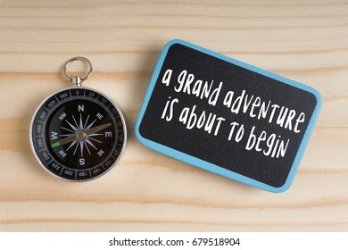 Travel inspirational quote with phrase a grand adventure  is about to begin.
