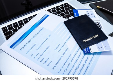 Travel insurance application form with a boarding pass and a passport