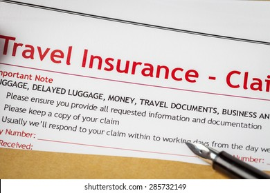 Travel Insurance Claim application form and pen on brown envelope, business insurance and risk concept; document is mock-up