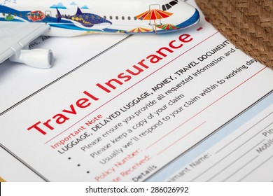 Travel Insurance Claim application form and hat with eyeglass on brown envelope, business insurance and risk concept; document and plane is mock-up