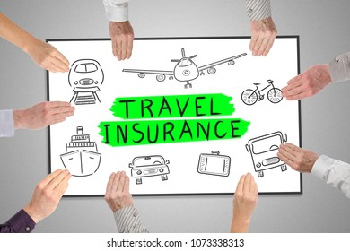 Travel insurance concept on a whiteboard held by hands