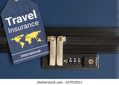 Travel insurance label is put near a numeric combination locks. Travel insurance is intended to cover medical expenses, trip cancellation, lost luggage and other losses incurred while traveling.